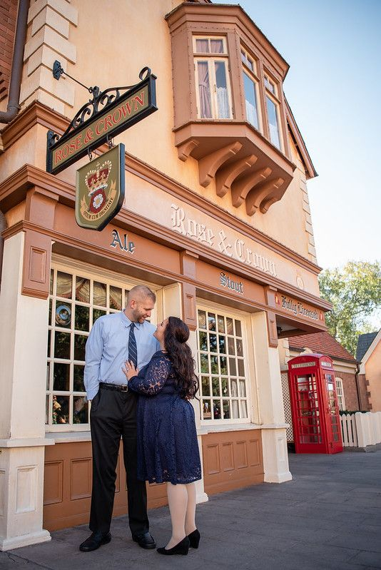 A couple standing in front of the Rose and Crown pub at the UK Pavilion at Walt Disney World's Epcot in Orlando FL