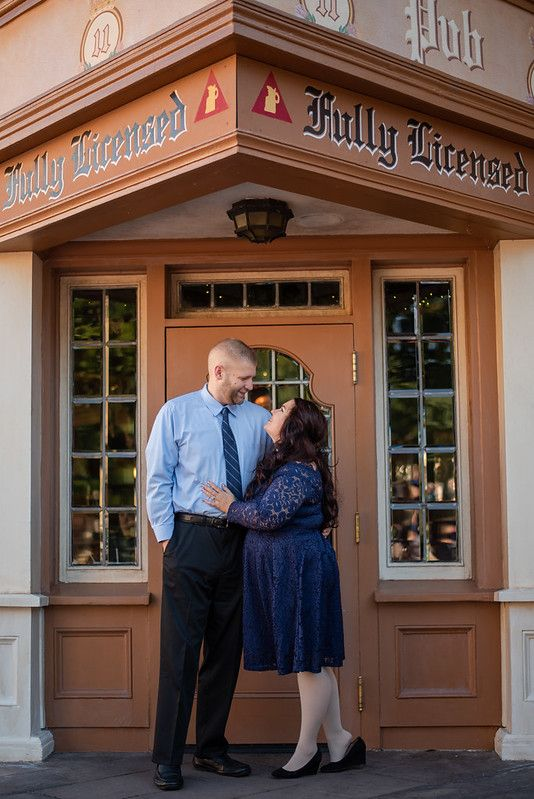 A couple standing in front of a pub door at the UK Pavilion at Walt Disney World's Epcot in Orlando FL
