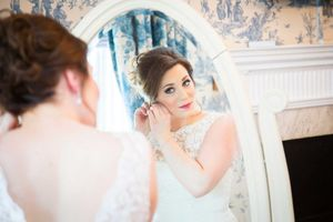 Bridal preps, bride looking in mirror
