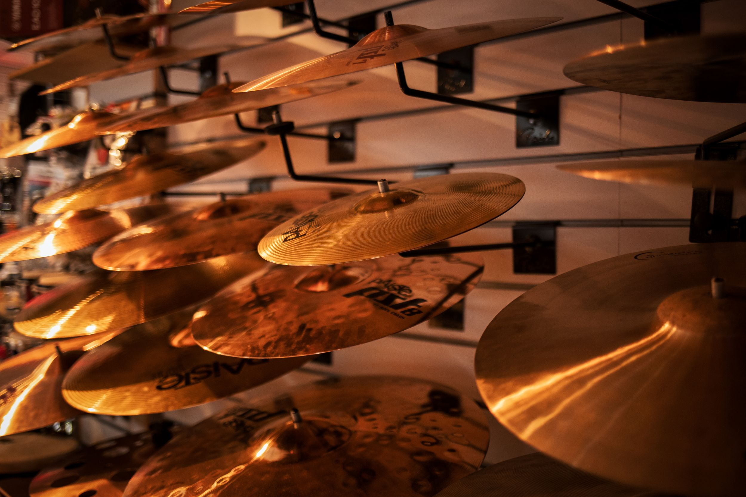 Light falling beautifully on this rack of Cymbals.