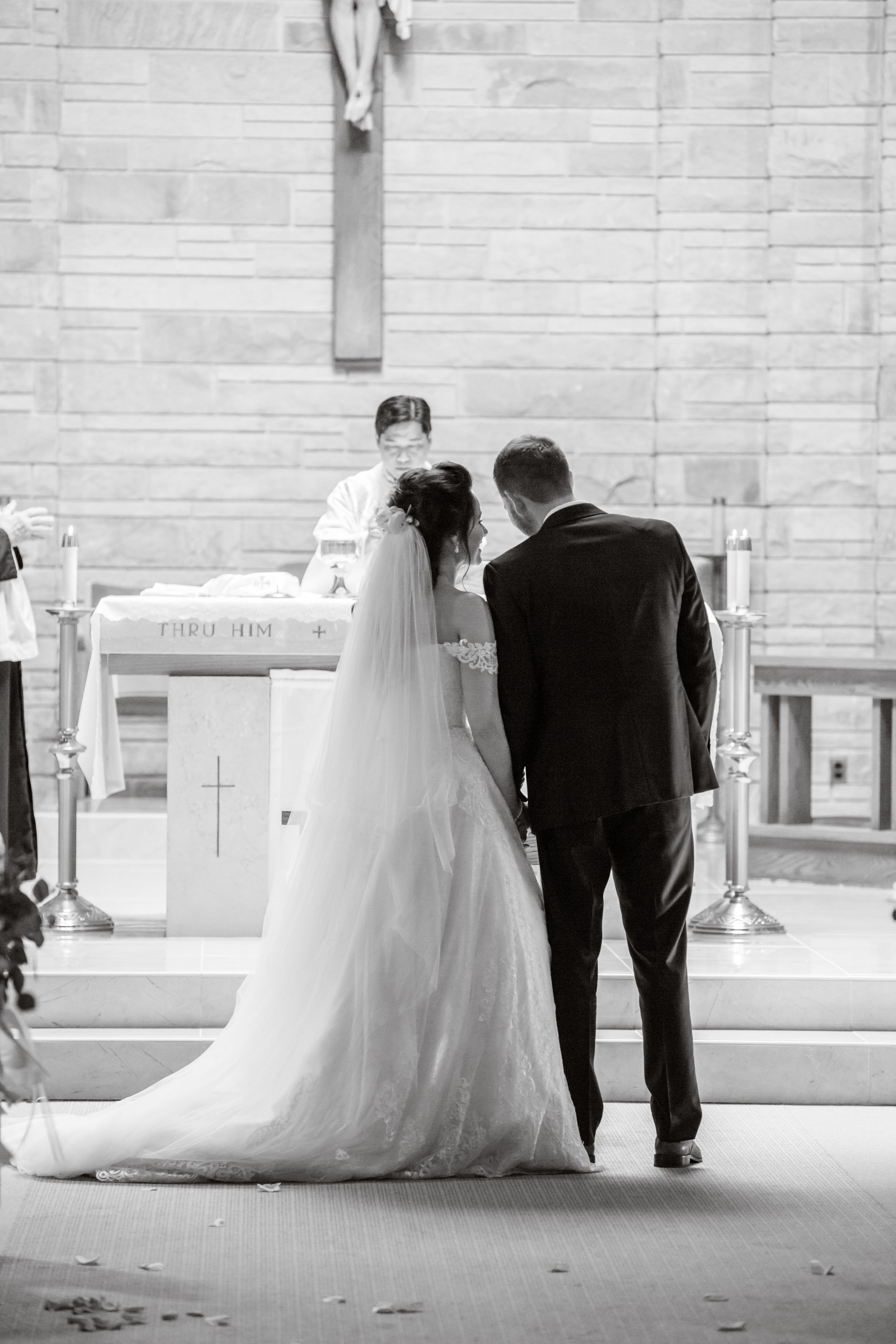 bride and groom at altar michigan wedding photographer