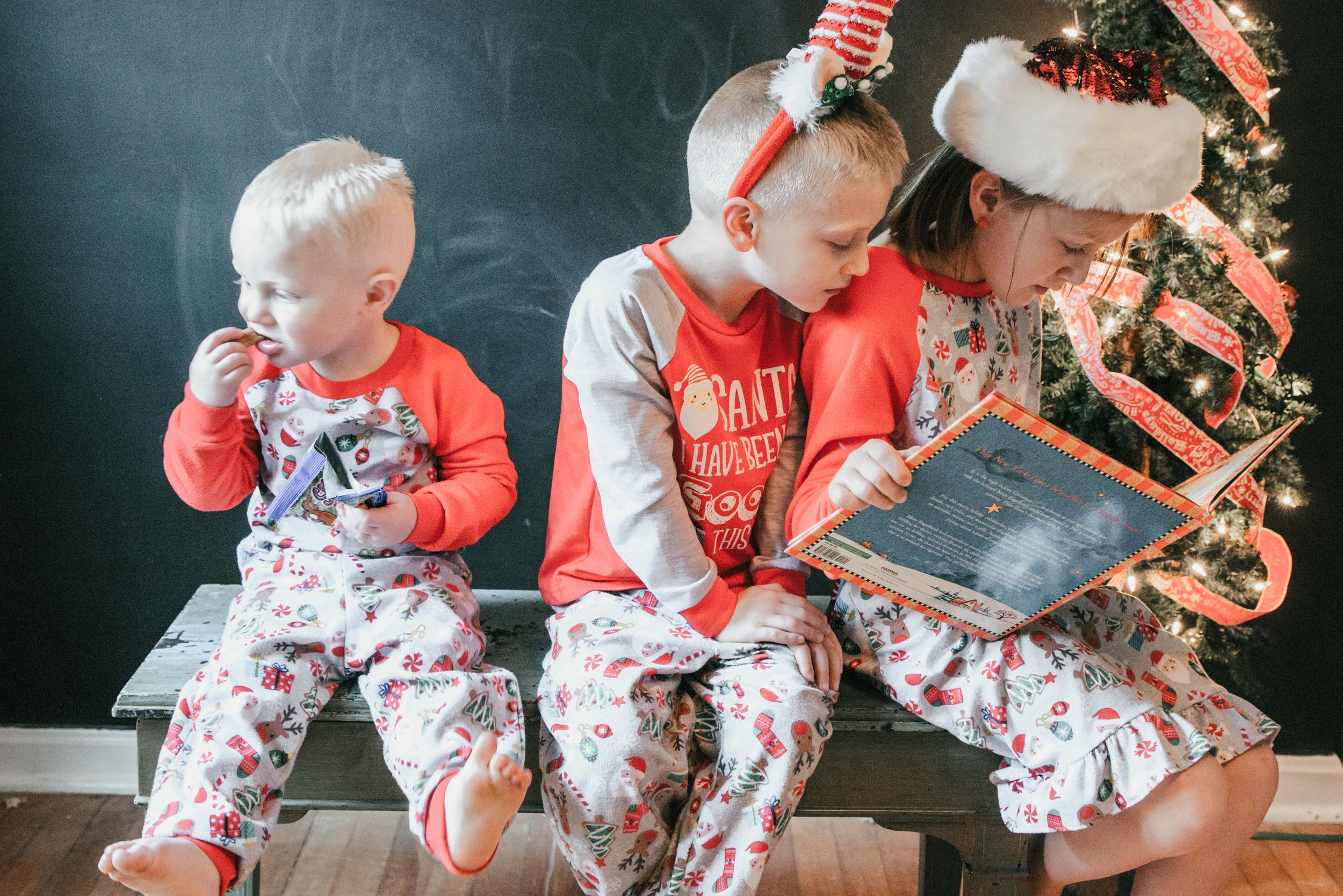 children reading book in Christmas pajamas, Shiny Penny Studios, Cleveland