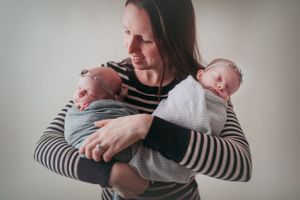 Twin Newborns Wrapped with Mom | Newborn Photography