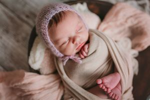 Newborn wrapped with bonnet | Newborn Photography