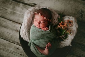 Newborn wrapped with tieback and brown eyed susans | Newborn Photography
