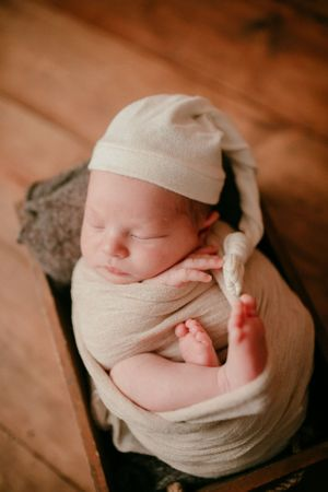 Newborn Wrapped and posed in wooden box | Newborn Photography