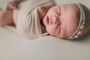 Newborn wrapped with tieback | Newborn Photography