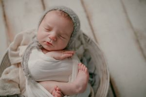 Newborn wrapped in basket | Newborn Photography