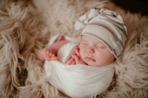 Newborn wrapped in fur | Newborn Photography