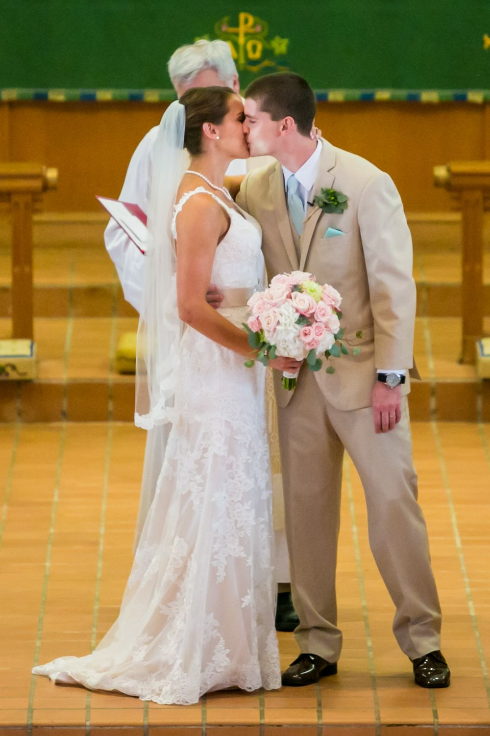 Alex and Mike have their first kiss during their wedding ceremony at Incarnation Lutheran Church in Columbia, SC.