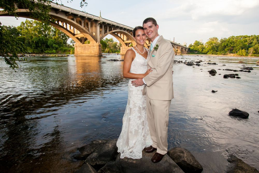 Bride Alex & groom Michael under the Gervais Street Bridge before their reception at Stone River in West Columbia, SC