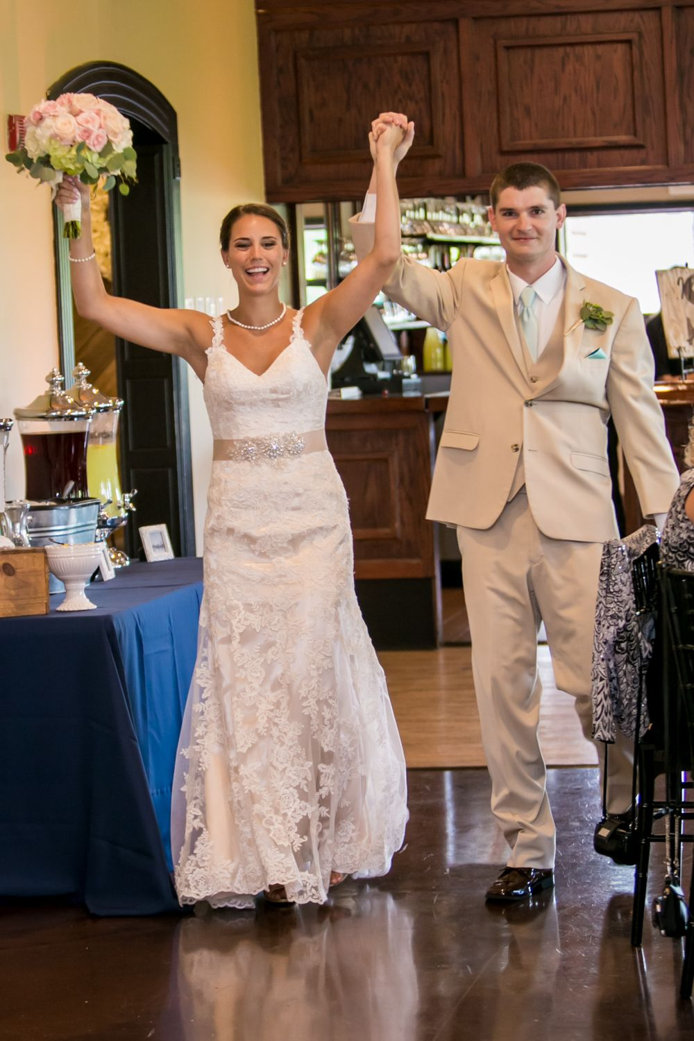 Bride Alex and groom Mike make their entrance at their wedding reception at Stone River in West Columbia, SC