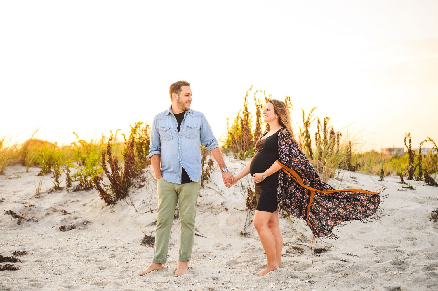 maternity couple on barnegat light beach during sunset