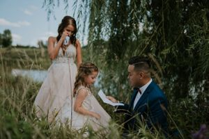 first-look-with-bride-and-daughter-crying-carper-winery-norwalk-iowa-raelyn-ramey-photography