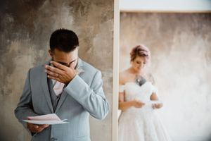 bride-and-groom-reading-letters-crying-summerset-winery-indianola-iowa-raelyn-ramey-photography