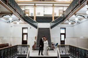 bride-groom-kissing-inside-of-courthouse-desmoines-iowa-raelyn-ramey-photography