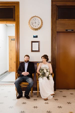 bride-groom-waiting-to-marry-in-courthouse-iowa-city-raelyn-ramey-photography