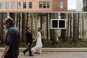 bride-groom-walking-in-the-streets-elopement-iowa-city-raelyn-ramey-photography