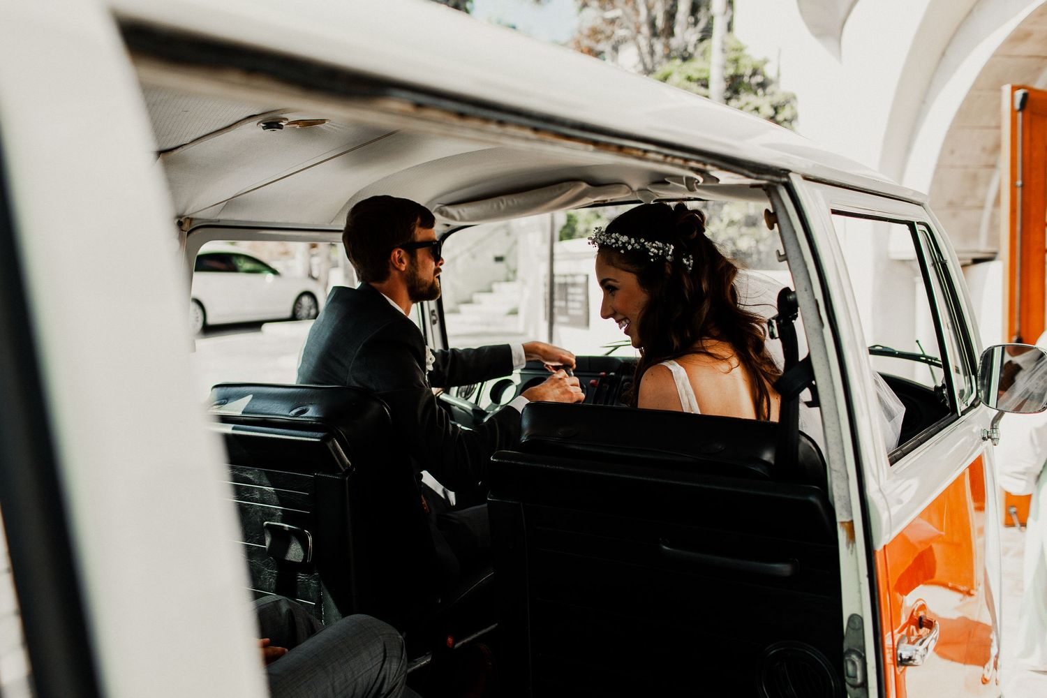 bride and groom inside volkswagon van