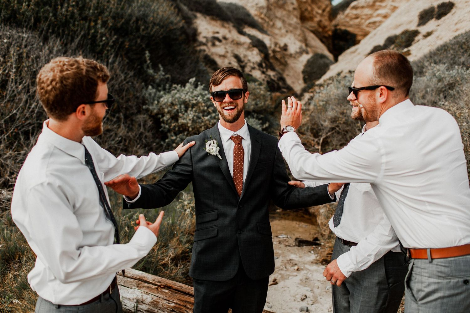 groomsmen congratulating each other at crystal cove
