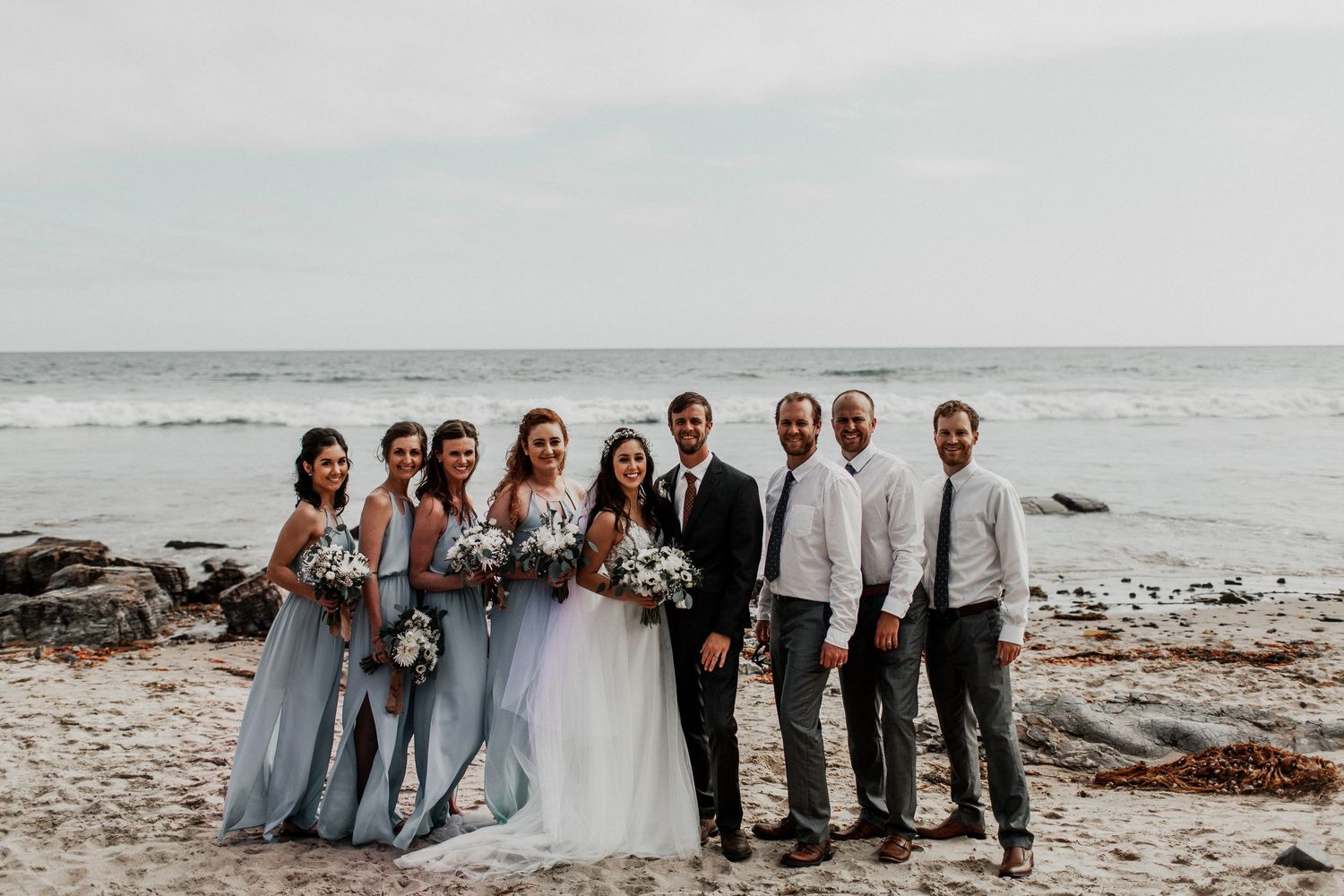 entire bridal party with crystal cove beach background