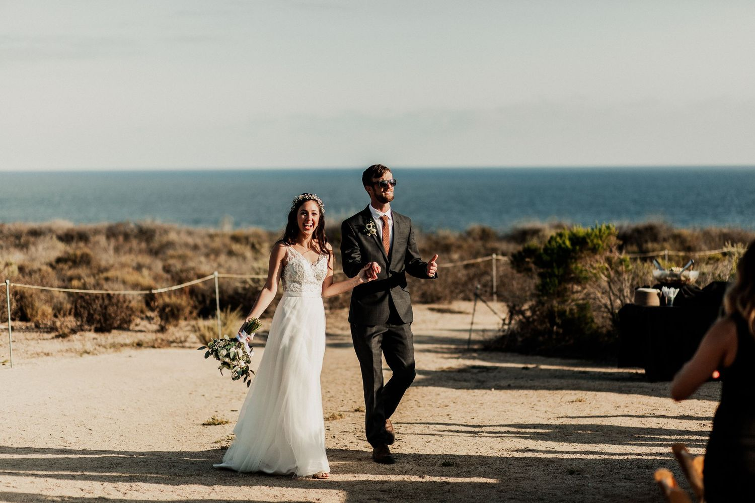 bride and groom walking to their reception at crystal cove