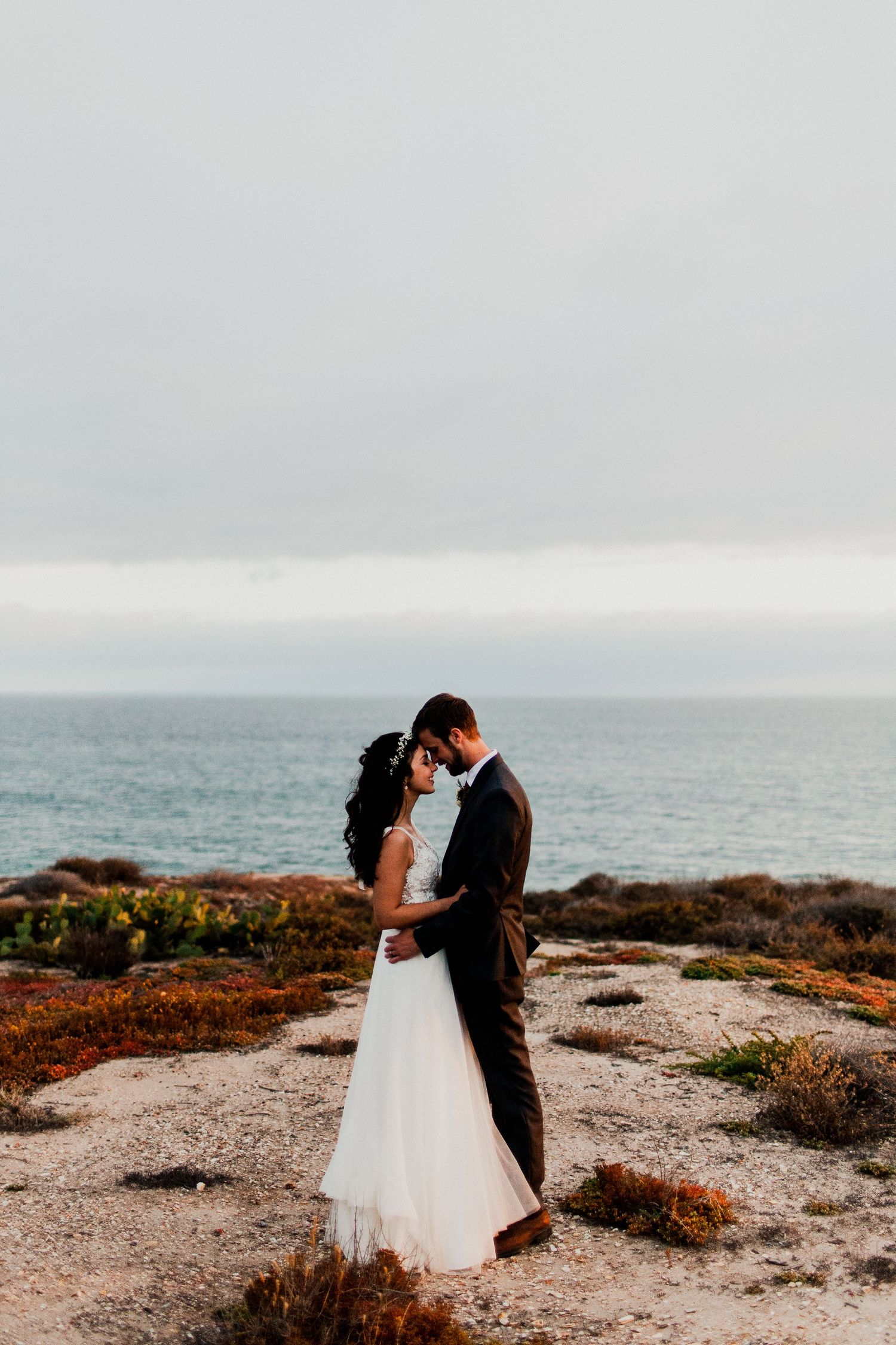bride and groom during golden hour at crystal cove