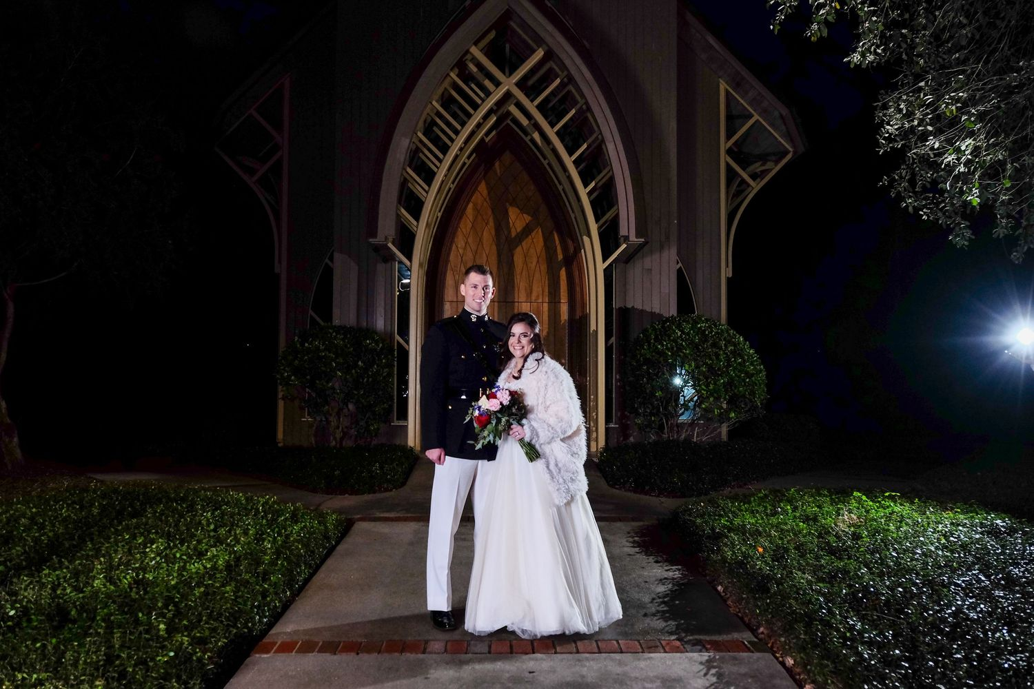 Portrait of bride and groom at night in front of the Baughman Center, Gainesville, Fl.