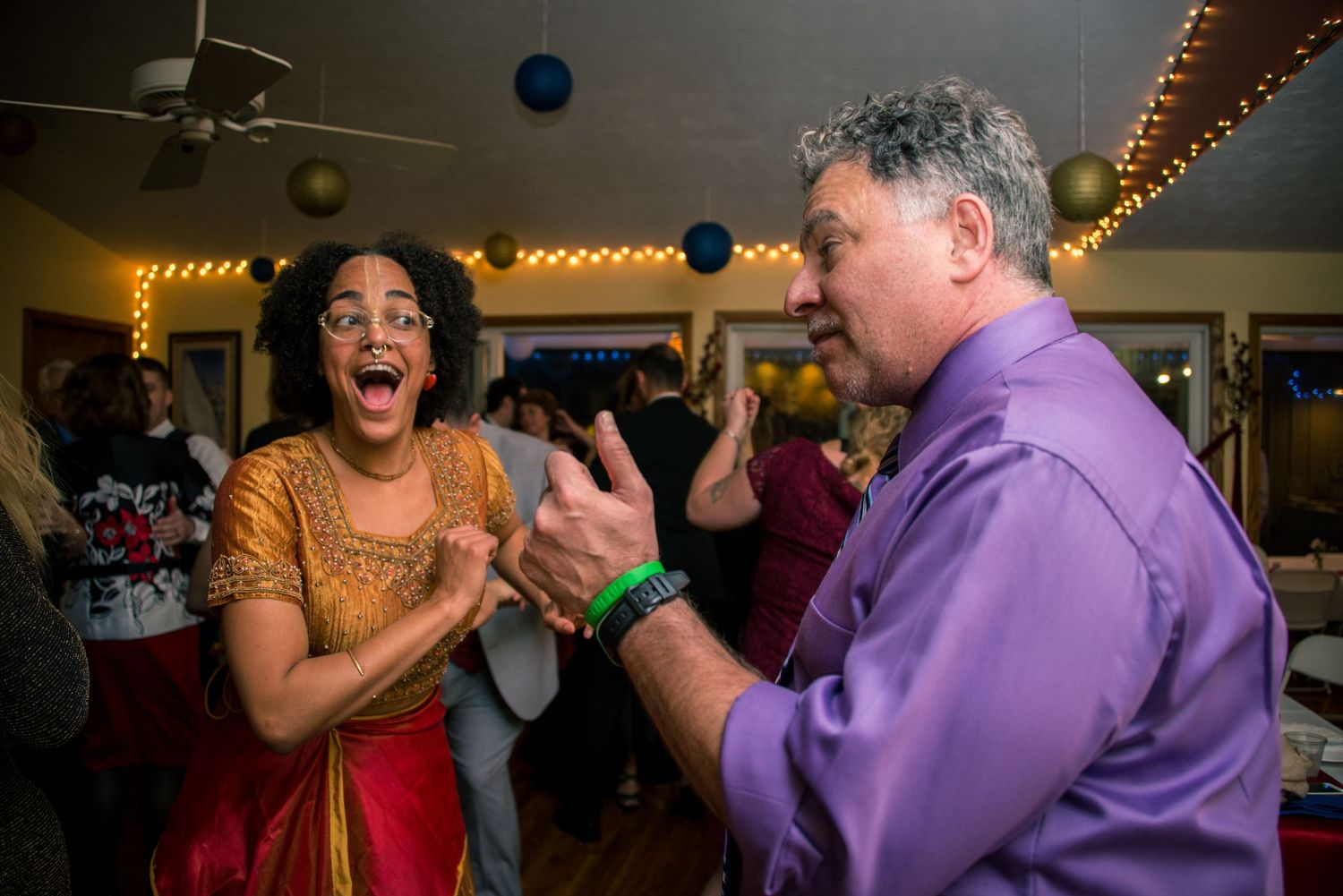 Two wedding guests dance at a backyard wedding near St. Augustine, Fl. Wedding Photographer Chris Watkins.