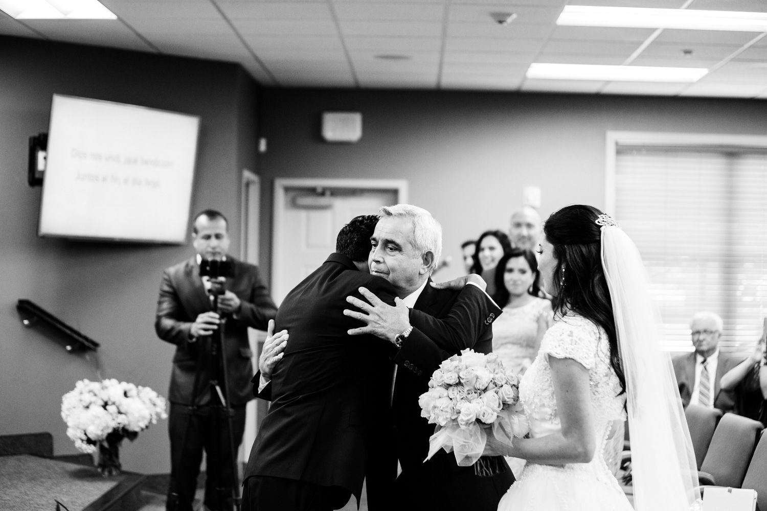 Bride's father hugs groom during Hudson Valley wedding ceremony