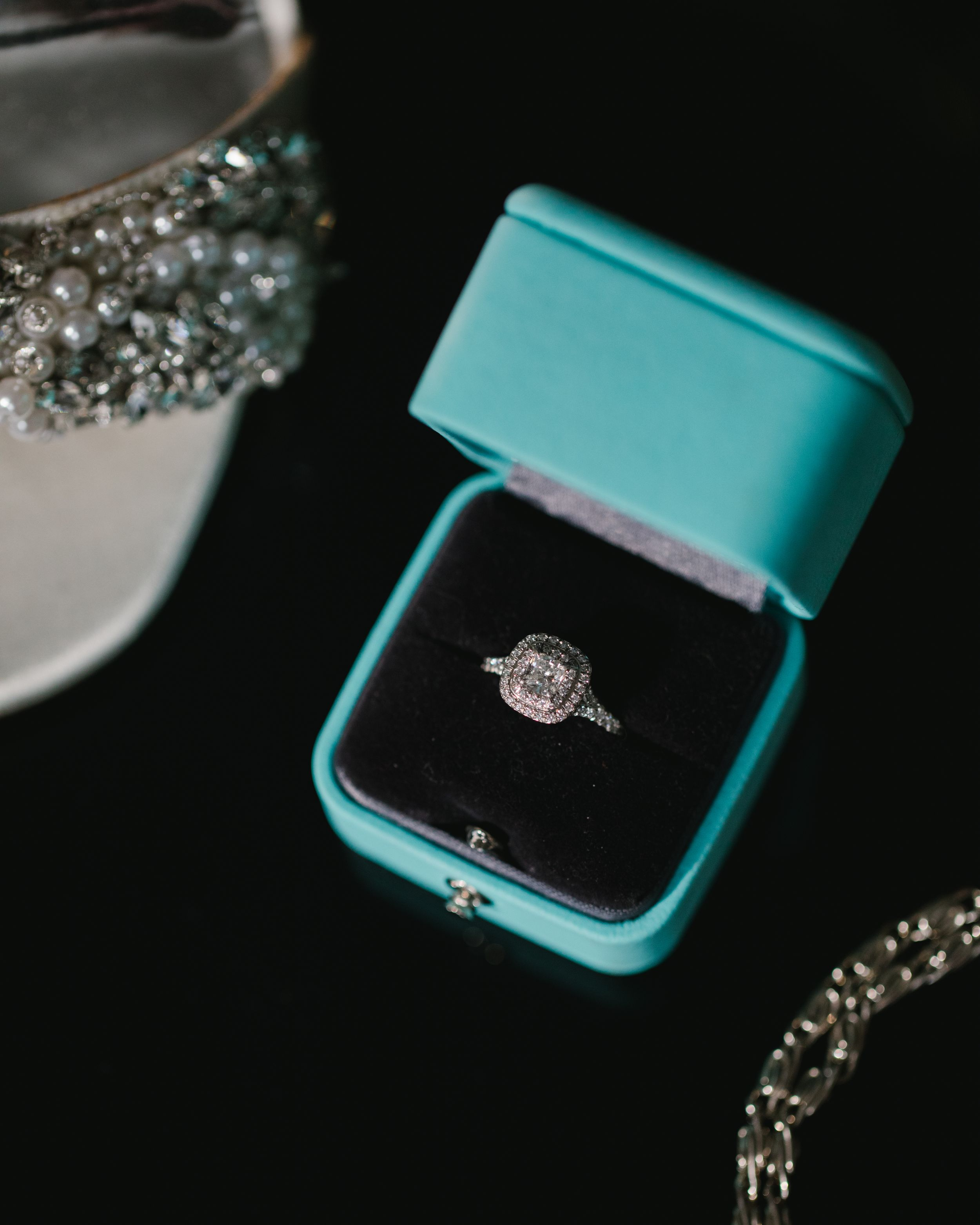 close up of engagement ring in tiffanys box
