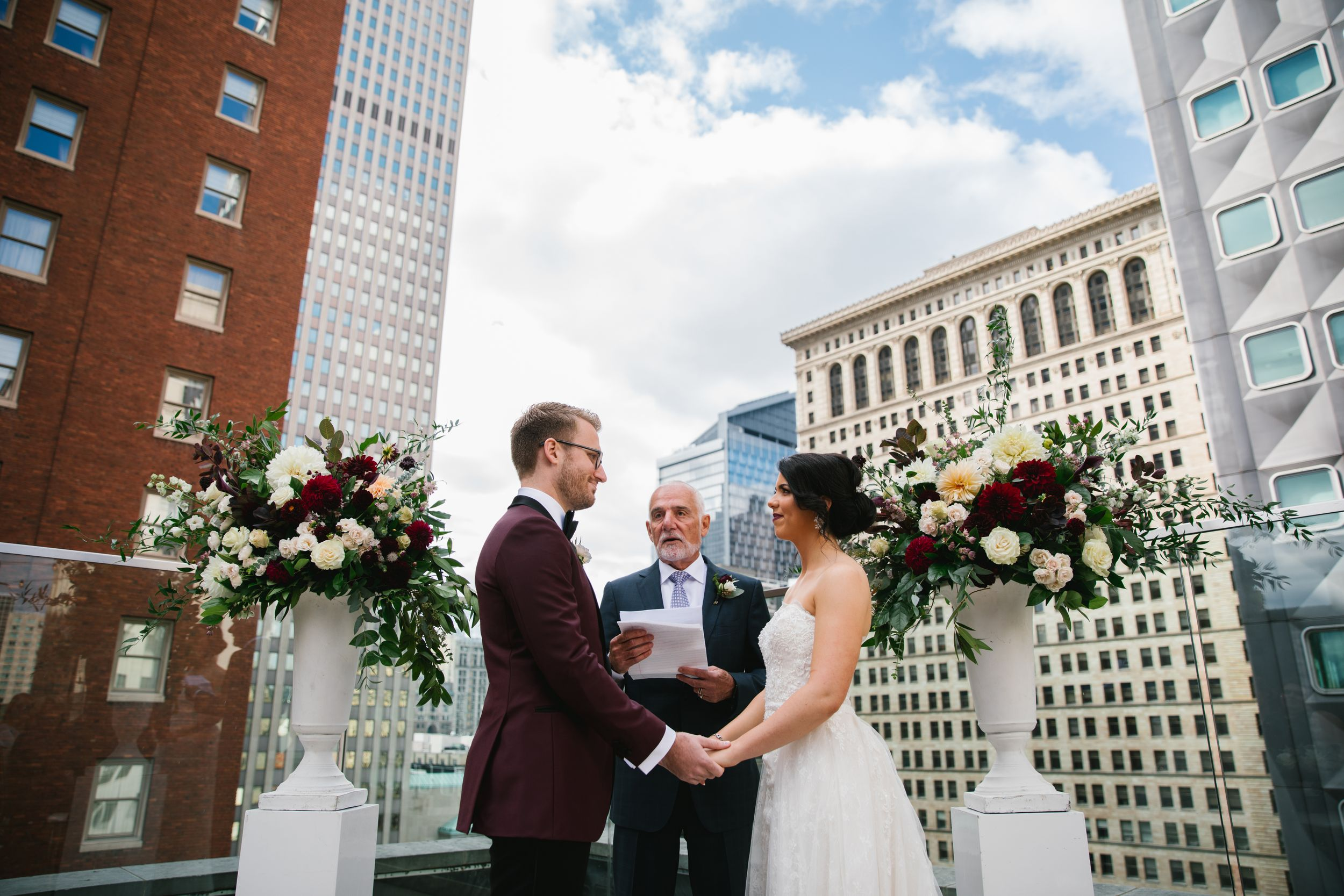 bride and groom holding hands during rooftop wedding ceremony toronto