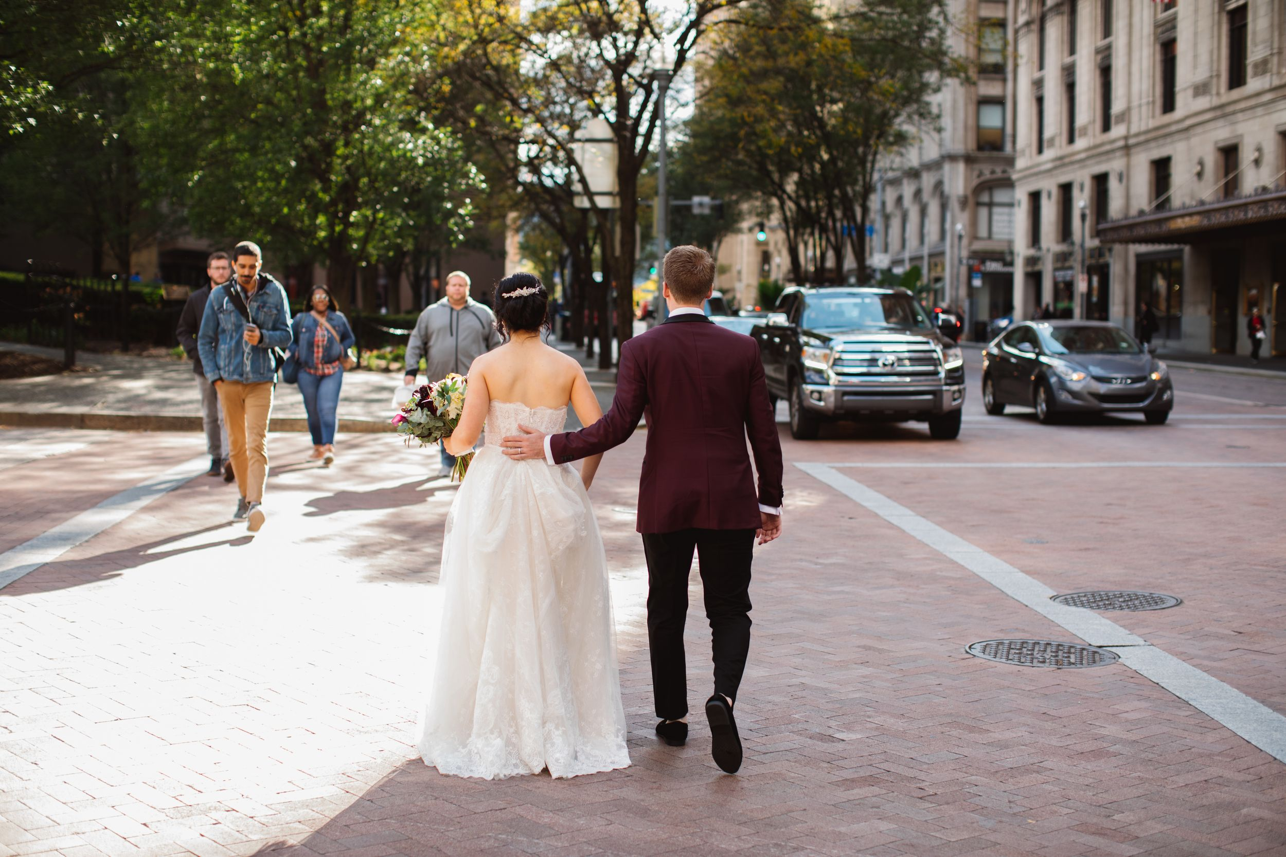 bride and groom crossing the street downtown wedding