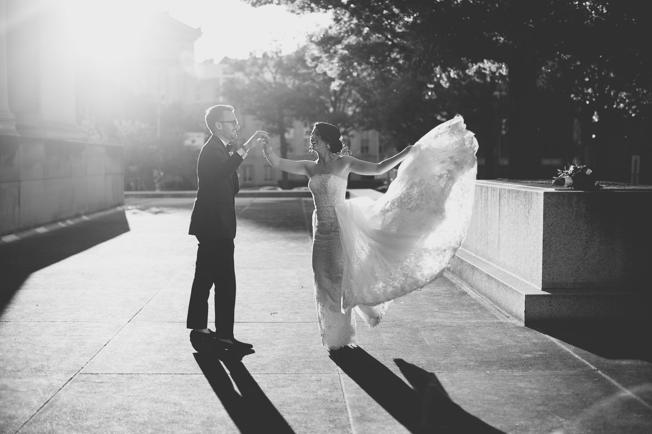 bride and groom black and white photo of him spinning her during sunset wedding toronto