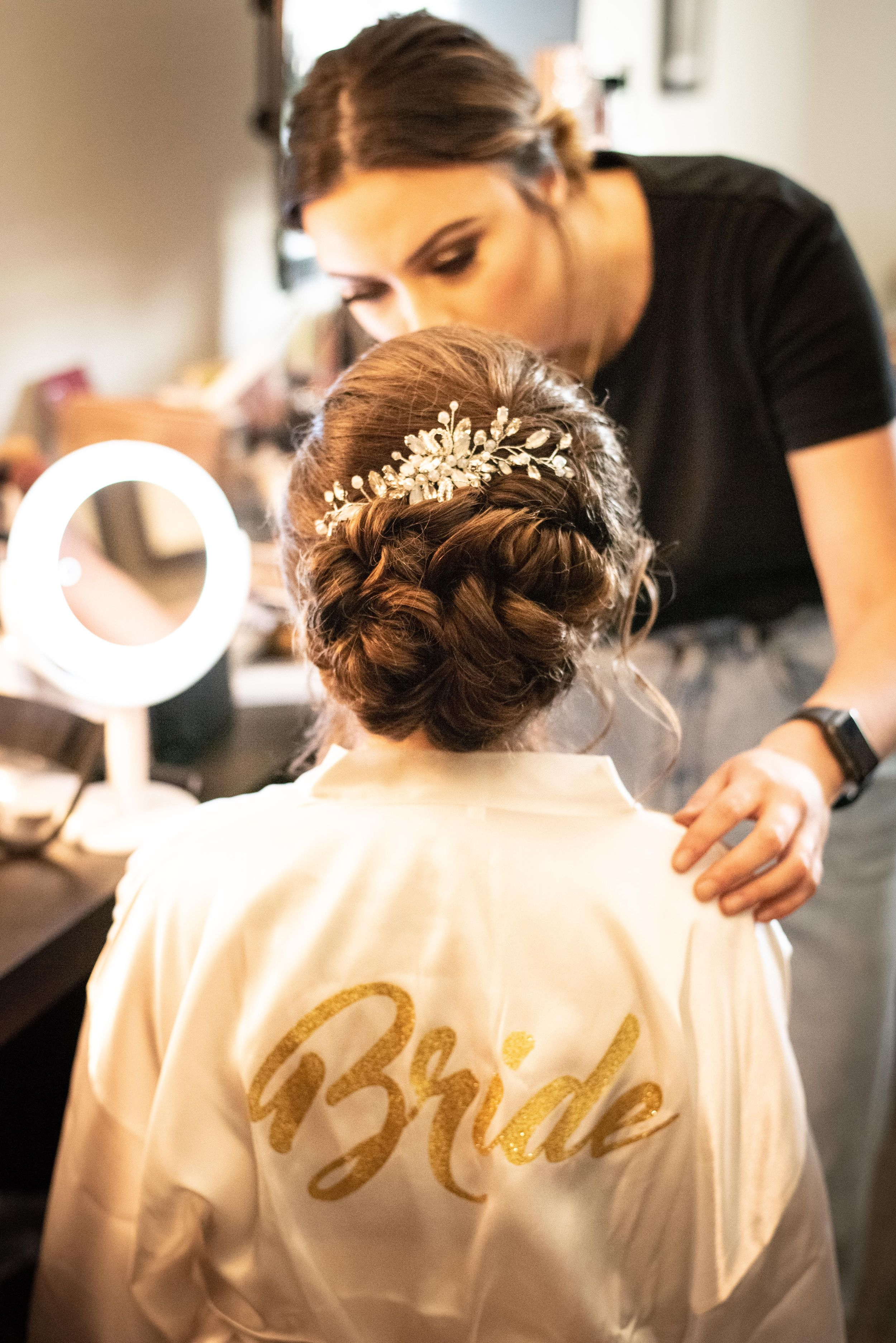 bride getting ready for wedding in robe