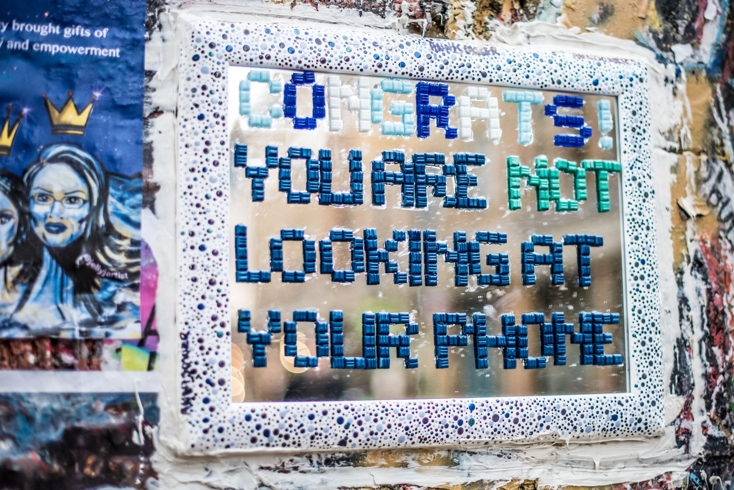 Congrats, you are not looking at your phone mirrored message on wall in London's artsy Shoreditch area.