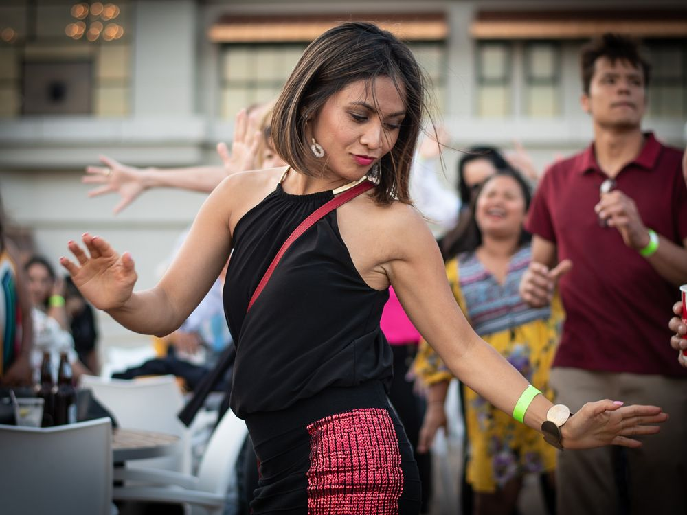Attractive Hispanic woman dancing.