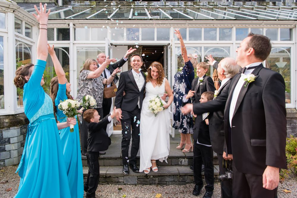 Couple exit after ceremony at Lakeside Hotel beside Windermere