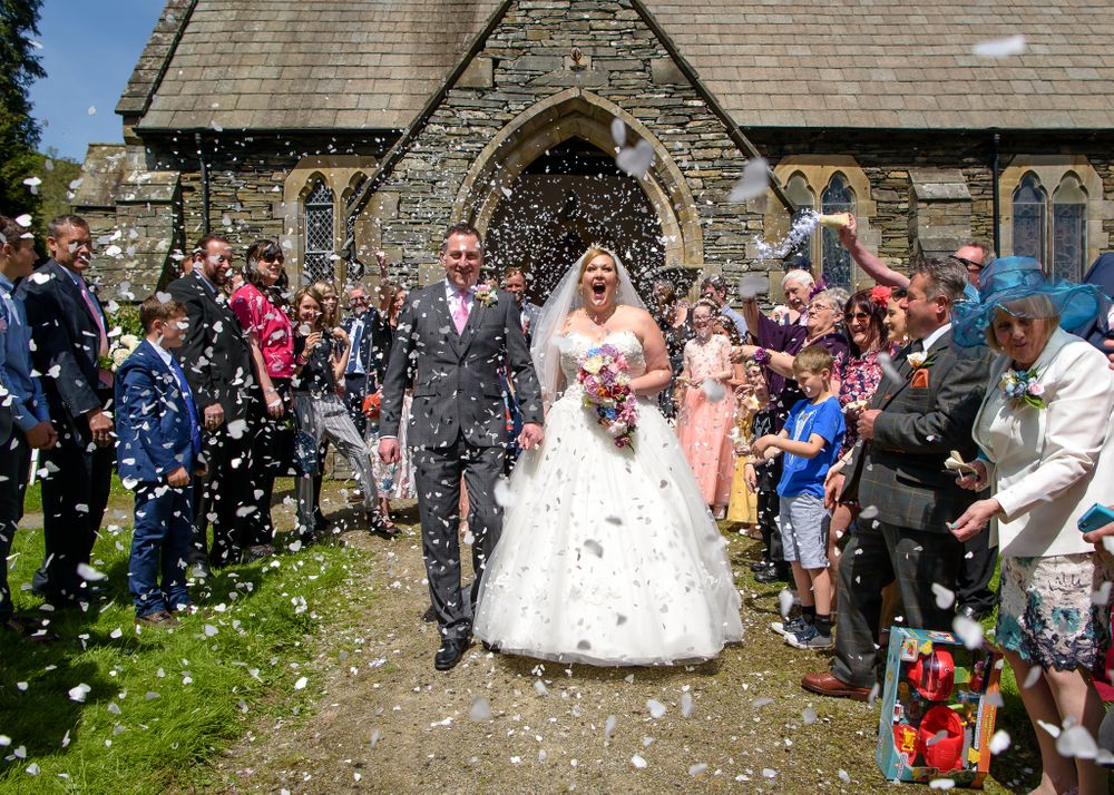 Confetti shower for bride and groom after Church wedding