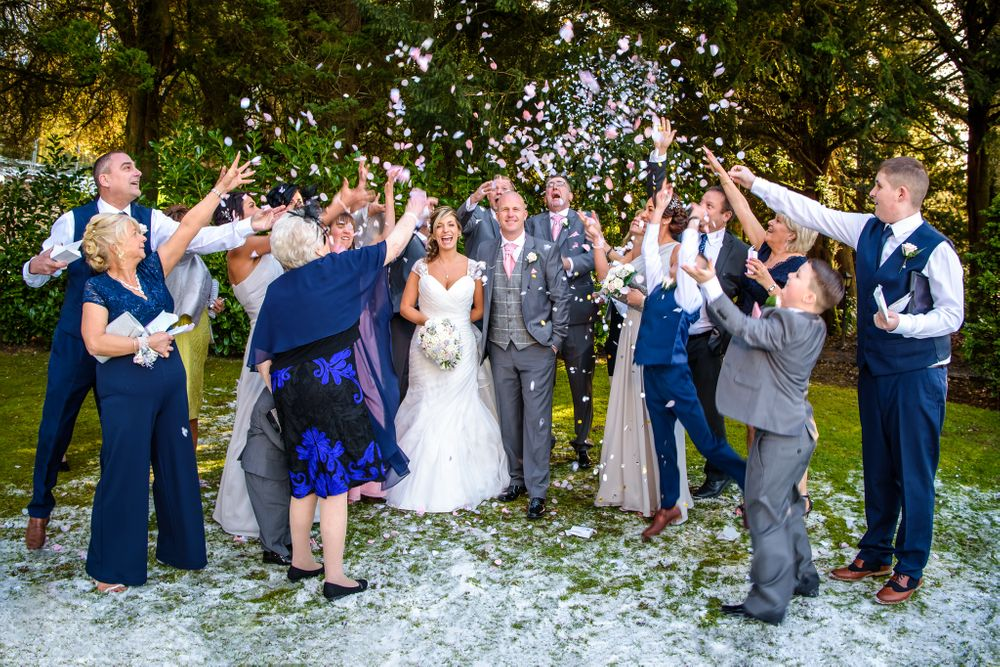 Guests throw confetti at winter wedding in Lake District