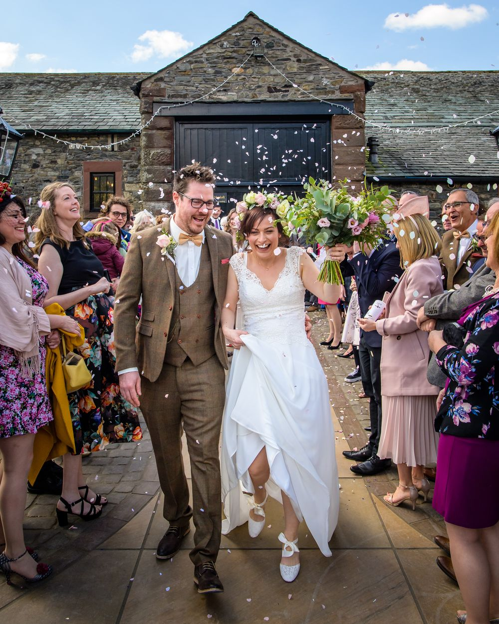 Couple showered with confetti at New House Farm in Lake District