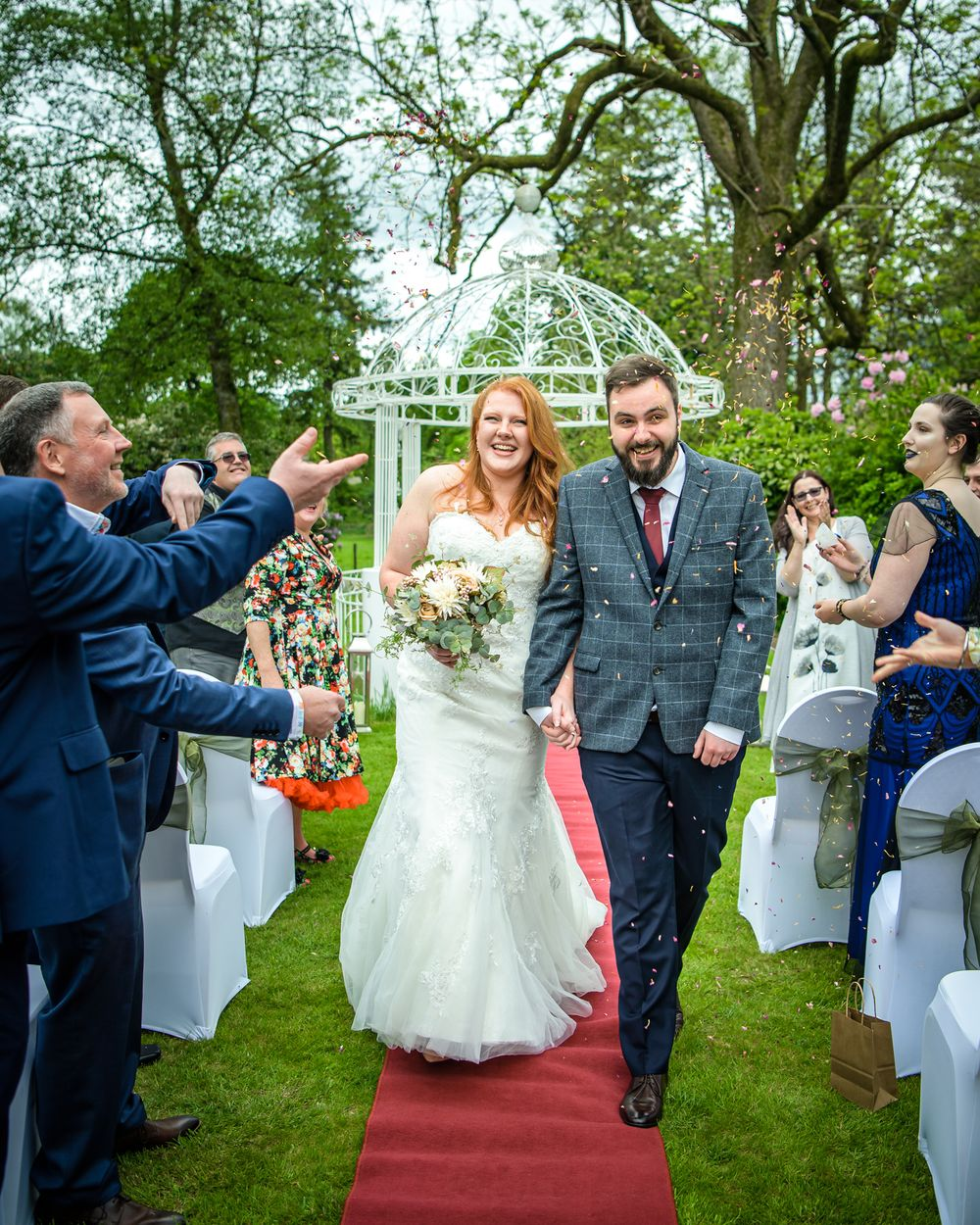 Couple showered with confetti at Wodsworth Hotel in Grasmere