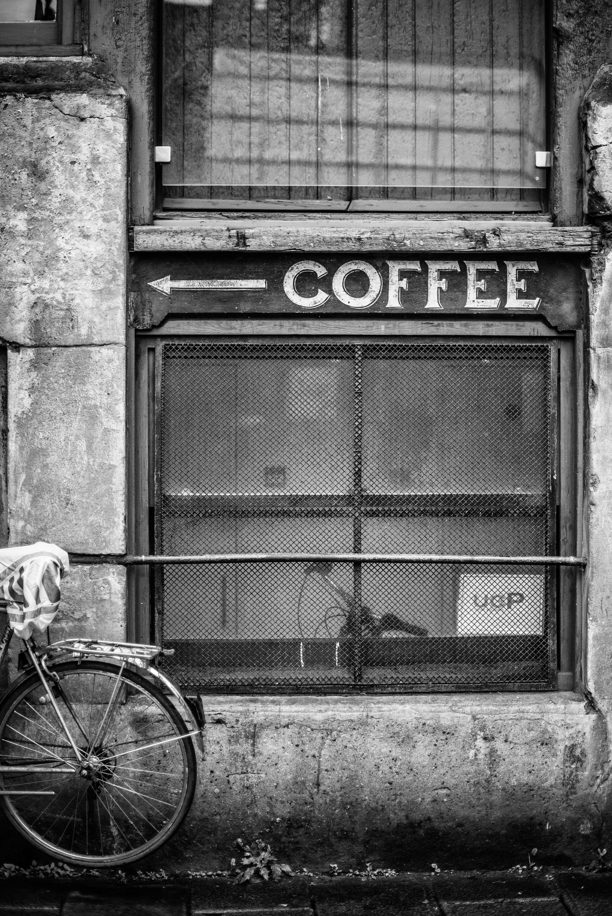 Coffee signage with arrow on a London side street