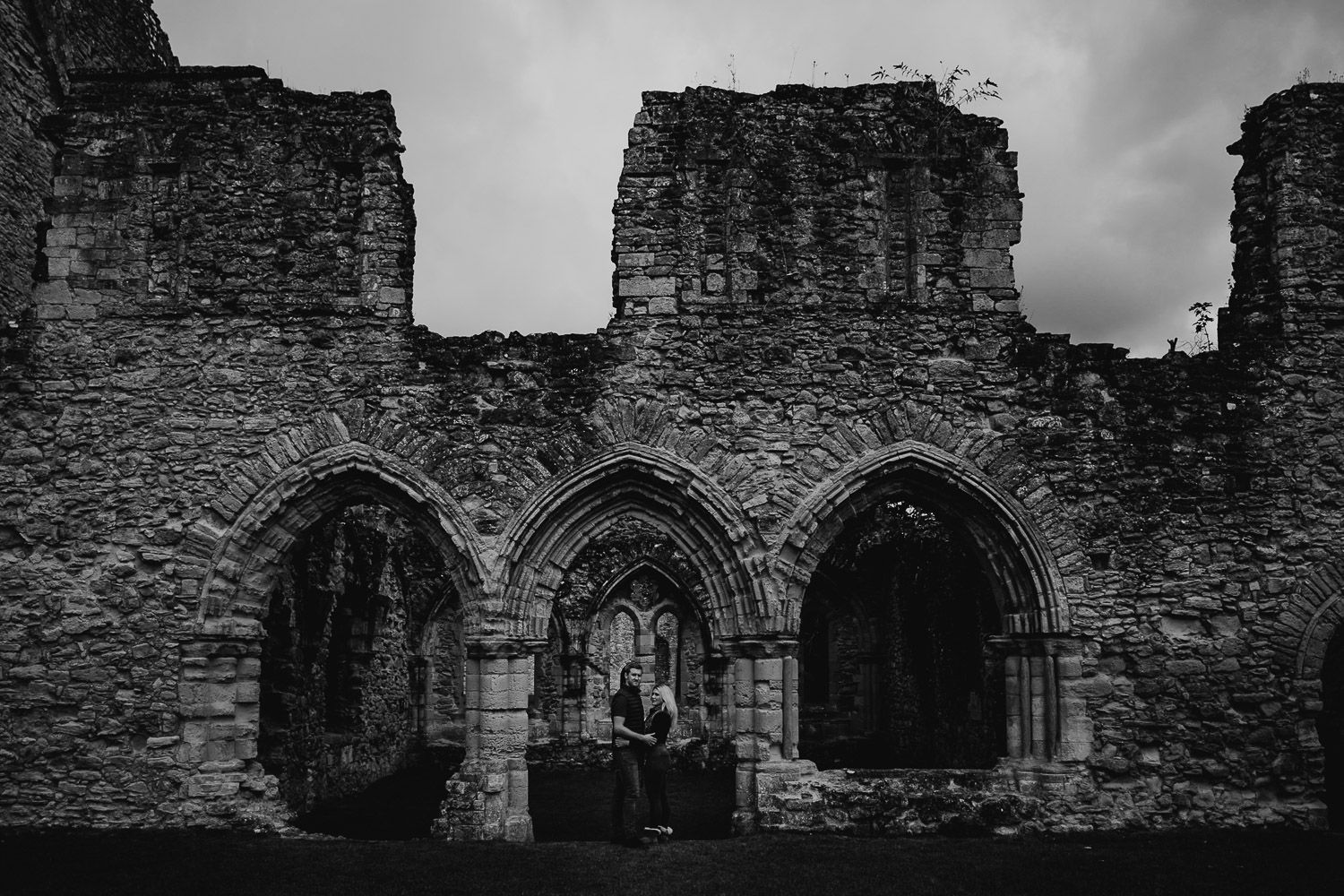 Black and white image of couple at Netley Abbey. Katherine and her Camera engagement photoshoot.