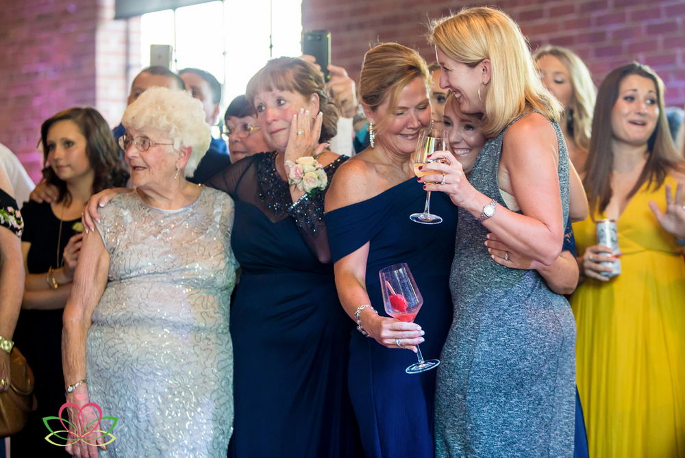 Mothers of the brides cry during the first dance at a same sex wedding at Senate's End in Columbia, SC