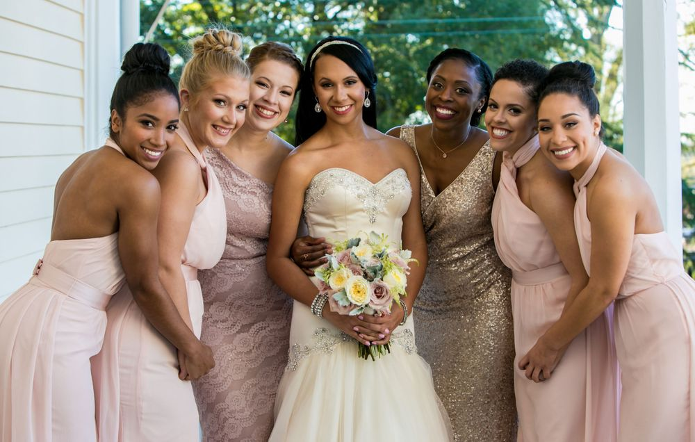 Miranda poses with her bridesmaids her wedding to Marcus Lattimore at the Lace House in Columbia, SC.Photo by Jeff Blake