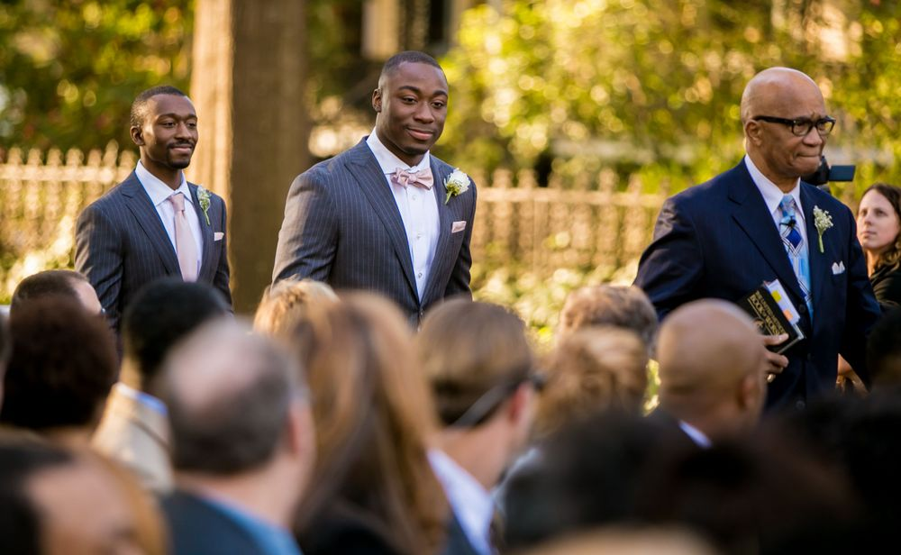 Marcus Lattimore walks down the aisle during his wedding at the Lace House in Columbia, SC. Photo by Jeff Blake