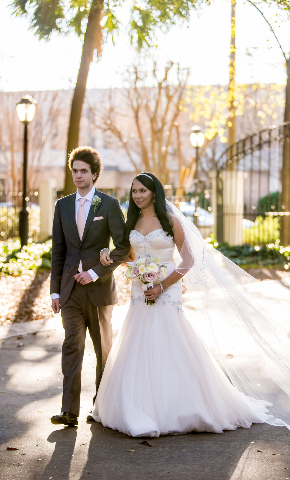 Miranda walks down the aisle with her brother during her wedding at the Lace House in Columbia, SC. Ph