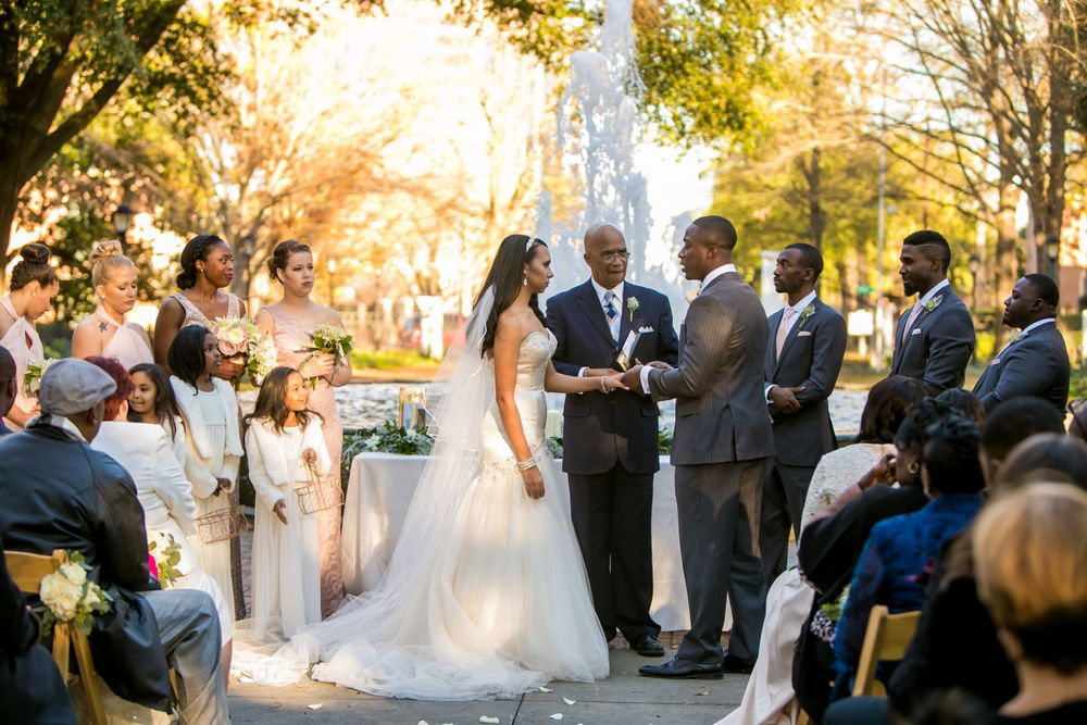 Miranda and Marcus Lattimore during their wedding ceremony at the Lace House in Columbia, SC. Ph