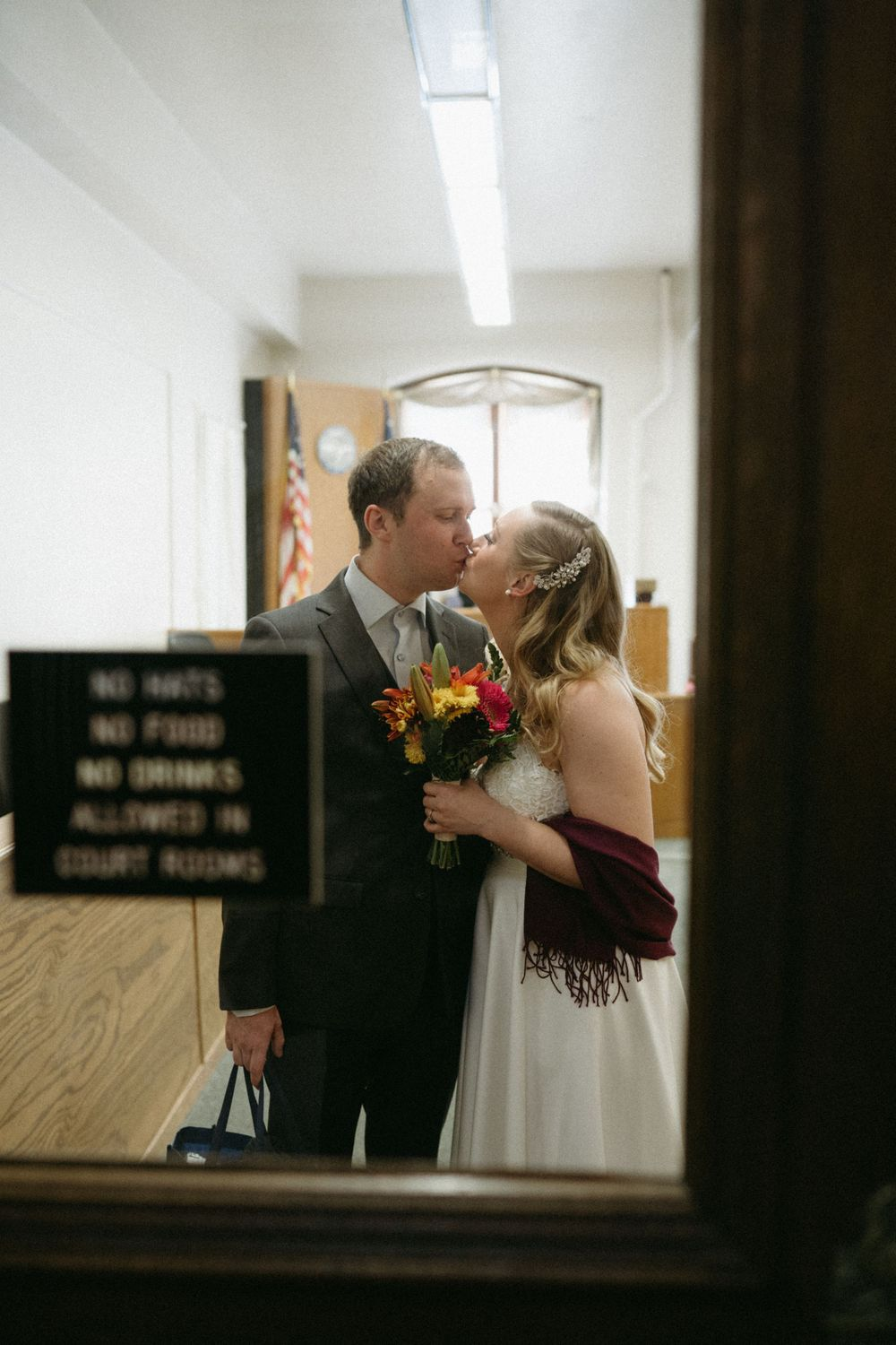 bride-groom-first-kiss-elopement-polk-county-courthouse-desmoines-iowa-raelyn-ramey-photography